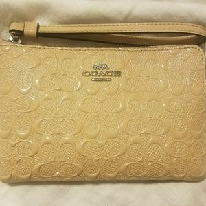 Coach Debossed wristlet cream patent leather